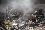 Fotografie close up photo of a burned out cars in garage after fire for grunge use
