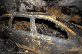 close up photo of a burned out cars in garage after fire for grunge use