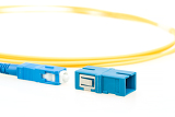 blue fiber optic sc connector and adaptor on white background