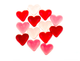 Fotografie brightly coloured red gums hearts as valentine present isolated on white background
