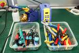 Photo electronics equipment assembly workplace with pliers and necessary tools