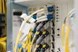 Photo fiber optic data center with media converters and optical cables