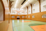 empty interior of public gym with basketball court
