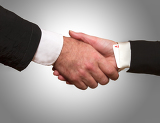 Woman hand with ace up the sleeve hand shake with man on a white background