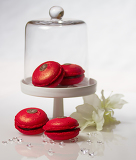 Fotografie Red Cherries and chocolate Macarons with flower,diamonds and glass hatch