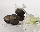 Fényképek Black Coffe macarons with diamonds,flower and white ribbon
