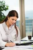 Businesswoman Writing In Office