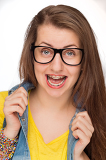 Crazy girl with braces wearing geek glasses