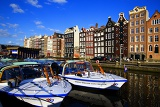 Fotografie City. Harbour, sea, gracht, house, waterfront, water and loď.Amsterdam - Netherlands.