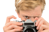Boy photographing with retro camera