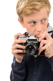 Suspicious teenage boy holding retro camera