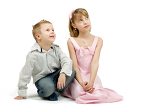 Fotografie studio portrait of siblings beautiful boy and girl on white background looking up
