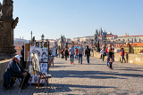 prague czech republic  march 13 charles bridge on march 13 2014 in prague czech republic charles bridge is a popular tourist attraction in prague on the bridge you can find many street artists