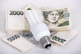 Fotografia saving money with energy saving bulb concept with czech banknotes crown