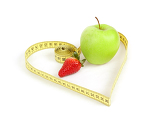 green apple and strawberry with a measuring tape and heart symbol isolated on white background