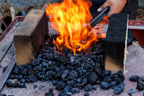outdoor old fashioned blacksmith furnace with burning coals