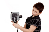 young boy with old vintage analog 8mm camera filming yourself