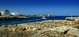 Summer, sea, bay, cliffs and lighthouse. The island of Mallorca.