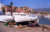 Photo Summer. The island, harbor, boats and Molyvos town. Greece - Lesbos.