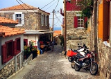 Summer. Ostrov, street, town houses and Molyvos. Greece - Lesbos.