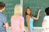Students standing front of green chalkboard math