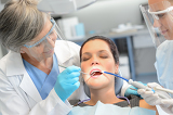 Dental check woman patient dentist team