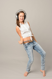 Fotografie Dancing girl with headphones singing enjoy music