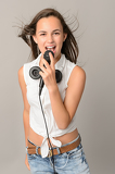 Fotografie Beautiful teenage girl singing with microphone