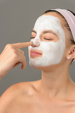 Fotografie Teenage beauty girl touch nose facial mask