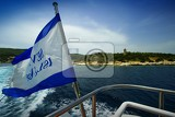 Fotografia Summer and sea. The island, flag, travel, cruise, ship and transport. Greece - Lefkada.