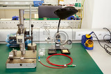 photo of electronics equipment assembly workplace with necessary tools