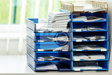 Photo documents and projects file folders on the shelves at office