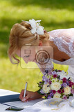 Fényképek beautiful blonde smiling bride signed wedding contract against green grass outdoor