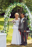 beautiful young couple in wedding ceremony outdoor blonde bride with flower and groom