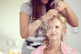 hair stylist designer making hairstyle for woman bride in wedding day