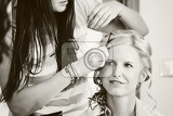 hair stylist designer making hairstyle for woman bride in wedding day black and white tone