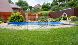 Fotografie small home swimming pool in rural garden in sunny day