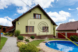 Fotografie repaired rural house fixed facade insulation and painted to green  color witg swimming pool