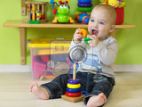 Fotografie a one year old child playing in his room