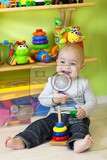 a one year old child playing in his room