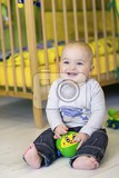Photo a one year old child playing in his room