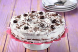 Fotografie chocolate cake with cream and cherries
