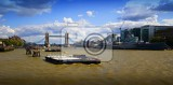City. Bridge, sky, clouds, transportation and the river Thames. London - England.