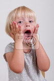 Fotografie Portrait of surprised blond little girl, Isolated on grey