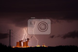 Fotografie Lightning storm over a nuclear power plant.