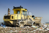 Photo Compactor moving trash in a landfill.