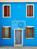 colorful houses taken on burano island  venice italy in summer time positive color makes beautiful background from them
