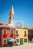 the colored houses near the old oblique church tower  burano venice italy