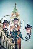 bell tower and street lamp on st mark
