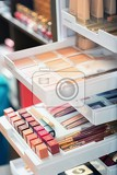 nail polish and other beauty products on the shelf in the beauty salon